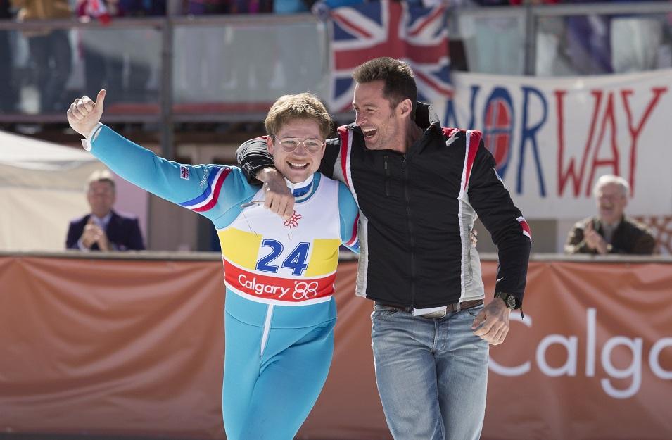 Tarom Egerton as Eddie and Hugh Jackman as his coach.