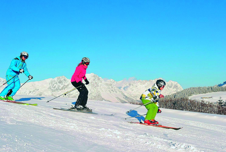 3 Kids sunny skiing